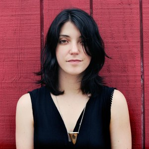 sharon-van-etten-against-a-red-fence